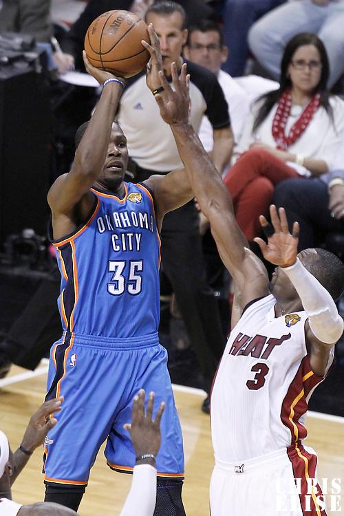 17 June 2012: Oklahoma City Thunder small forward Kevin Durant (35) takes a jumpshot over Miami Heat shooting guard Dwyane Wade (3) during the Miami Heat 91-85 victory over the Oklahoma City Thunder, in Game 3 of the 2012 NBA Finals, at the AmericanAirlinesArena, Miami, Florida, USA.