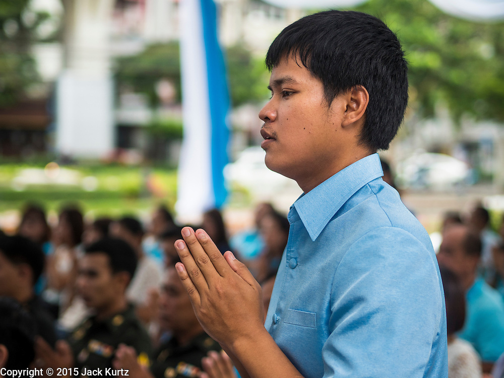 11 AUGUST 2015 - BANGKOK, THAILAND: A man prays during a service to honor Queen Sirikit of Thailand before her 83rd birthday. Queen Sirikit was born Mom Rajawongse Sirikit Kitiyakara on August 12, 1932. She is the queen consort of Bhumibol Adulyadej, King (Rama IX) of Thailand. She met Bhumibol in Paris, where her father was the Thai ambassador. They married in 1950, she was appointed Queen Regent in 1956. The King and Queen had one son and three daughters. She has not made any public appearances since her hospitalization in 2012. Her birthday is celebrated as Mother's Day in Thailand, schools and temples across Thailand hold ceremonies to honor the Queen and mothers.      PHOTO BY JACK KURTZ
