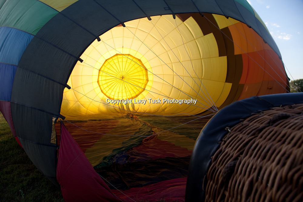 Silhouettes through a hot air balloon