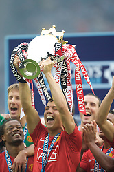 WIGAN, ENGLAND - Sunday, May 11, 2008: Manchester United's Cristiano Ronaldo lifts the trophy after winning the Premier League after the final Premiership match of the season at the JJB Stadium. (Photo by David Rawcliffe/Propaganda)
