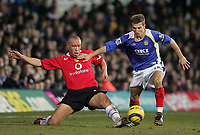 Photo: Lee Earle.<br /> Portsmouth v Manchester United. The Barclays Premiership. 11/02/2006. United's Mikael Silvestre (L) battles with Gary O' Neil.