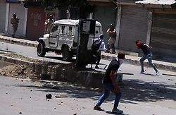 May 27, 2017 - Srinagar, Jammu and Kashmir, India - Protester clashes government forces in Srinagar May 27, 2017 .  civilian was killed and dozens of others injured in Indian-controlled Kashmir following the killing of a top militant commander and his associate during a  gunbattle with government forces (Credit Image: © Umer Asif/Pacific Press via ZUMA Wire)