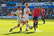 Joel Lynch (33) of Queens Park Rangers is challenged by Connor Roberts (23) of Swansea City during the EFL Sky Bet Championship match between Swansea City and Queens Park Rangers at the Liberty Stadium, Swansea, Wales on 29 September 2018.
