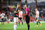 Nottingham Forest defender Matthew Mills (5)  is shown a yellow card, booked during the EFL Sky Bet Championship match between Brentford and Nottingham Forest at Griffin Park, London, England on 16 August 2016. Photo by Matthew Redman.