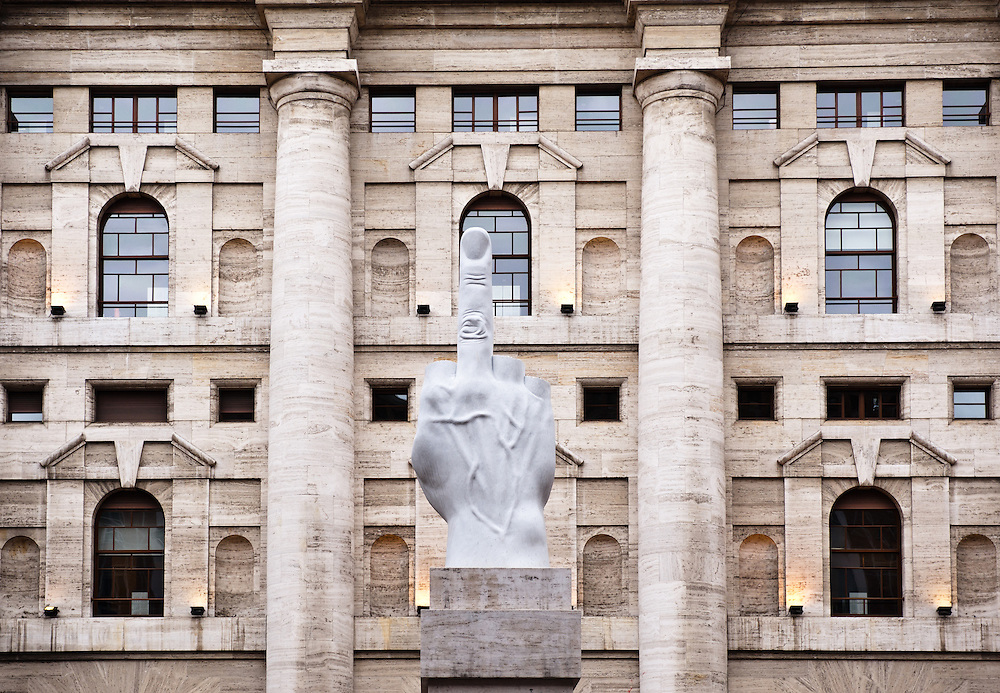 Maurizio Cattelan L.O.V.E. sculpture pointing away from Milan's stock market