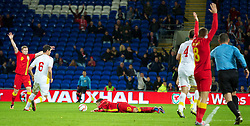 CARDIFF, WALES - Friday, October 11, 2013: Wales' captain Aaron Ramsey is brought down by Macedonia's Nikolce Noveski for a penalty during the 2014 FIFA World Cup Brazil Qualifying Group A match at the Cardiff City Stadium. (Pic by David Rawcliffe/Propaganda)
