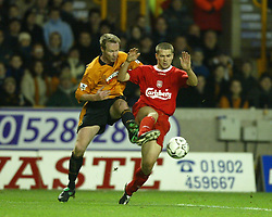 WOLVERHAMPTON, ENGLAND - Wednesday, January 21st, 2004: Liverpool's Michael Owen and Wolverhampton Wanderers' Jody Craddock during the Premiership match at Molineux. (Pic by David Rawcliffe/Propaganda)