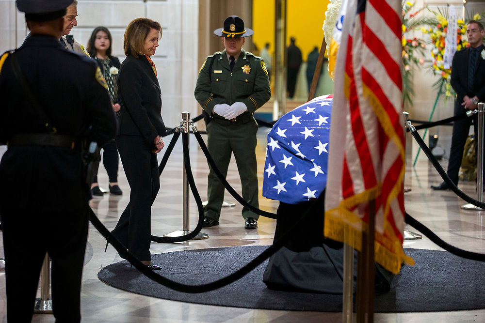 Nancy Pelosi takes a moment as San Francisco Mayor Ed Lee lies in state at City Hall on Friday, Dec. 15, 2017, in San Francisco, Calif. Lee died on Tuesday from a heart attack. He was 65 years old.