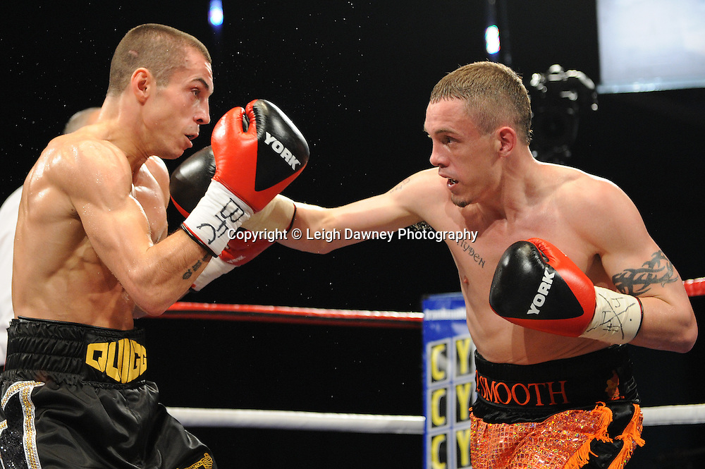 Scott Quigg (black shorts) defeats Jason Booth claiming the British Super Bantamweight Title at the Premier Suite, Reebok Stadium, Bolton, UK on 22.10.11. Frank Maloney Promotions. Photo credit: © Leigh Dawney.