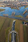 Nederland, Limburg, Roermond, 2011-01-10; Roerdal met riviertje de Roer, ten zuiden van Roermond. Door het hoogwater zijn landerijen onder water te komen staan. Boven in beeld de ingang van de Roertunnel..Valley of River Roer, south of Roermond. Because of the high water the land is submerged. High water due to snow melt and precipitation upstream. .Notice entrance tunnel..luchtfoto (toeslag), aerial photo (additional fee required).foto/photo Siebe Swart