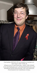Comedian STEPHEN FRY at a party in London on 13th March 2001.OME 39