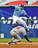 April 13, 2008 - Kansas City, MO..Shortstop Tony Pena Jr. #1 of the Kansas City Royals leaps over Jason Kubel #16 of the Minnesota Twins after making a throw to first inning for an inning ending double play in the fourth inning, during a Major League Baseball game at Kauffman Stadium in Kansas City, Missouri on April 13, 2008...The Royals defeated the Twins 5-1.  .Peter G. Aiken/CSM