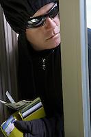 Burglar stealing money, close-up