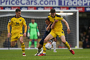 Rob Dickie of Oxford United holds back Simon Cox of Southend United during the EFL Sky Bet League 1 match between Southend United and Oxford United at Roots Hall, Southend, England on 6 October 2018.