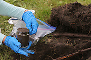 EPA contractors from the SCST engineering firm take soil samples last week in Calumet zone 2 in East Chicago.