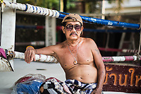 A portrait of Prawit Tue-U, Dejdamrong Sor Amnuaysirichoke's old trainer, at his home boxing ring--Lukbanyai Gym--in Bangkok, Thailand.