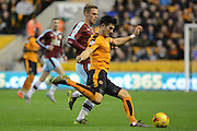 Wolverhampton Wanderers defender Danny Batth clears from Burnley striker Rouwen Hennings during the Sky Bet Championship match between Wolverhampton Wanderers and Burnley at Molineux, Wolverhampton, England on 7 November 2015. Photo by Alan Franklin.