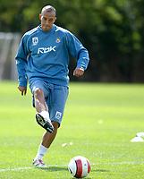 Photo: Daniel Hambury.<br />West Ham United Media Day. 10/08/2006.<br />Bobby Zamora passes the ball during training.