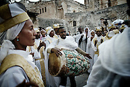 Ethiopian Orthodox Christian clergy outside Deir Al-Sultan on the roof of the Church of the Holy Sepulcher, traditionally believed to be the site of the crucifixion of Jesus Christ, burial and resurrection of Jesus Christ, as they pray and commemorate the Holy Fire in Jerusalem's Old City