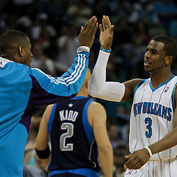 12 April 2009: New Orleans Hornets guard Chris Paul (3) celebrates with New Orleans Hornets' Antonio Daniels as he walks off the court for a timeout during NBA game between the New Orleans Hornets and the Dallas Mavericks on Easter Sunday at the New Orleans Arena in New Orleans, Louisiana.
