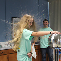 RAY VAN DUSEN/BUY AT PHOTOS.MONROECOUNTYJOURNAL.COM<br /> Riley Ross of Becker has a hair-raising experience after keeping her hand on a Van de Graff generator as part of a lesson on electricity during bring your child to work day at Tronox.