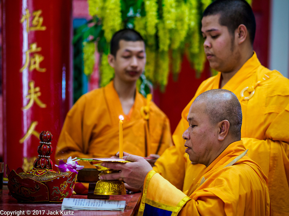 04 SEPTEMBER 2017 - BANGKOK, THAILAND: Chinese Buddhist monks lead a prayer before a food distribution at Chaomae Thapthim Shrine. About 1,000 people came to the shrine for the annual food distribution. Staples, like rice and cooking oil, are donated to the shrine throughout the year and donated to poor people from the communities around the shrine. Food distributions like this are a tradition at Chinese shrines in Bangkok and a common way of making merit for the people who donate the staples.     PHOTO BY JACK KURTZ