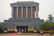 Guards stand outside the Ho Chi Minh Tomb  at Ba Ðình Square in Hanoi, Vietnam. The tomb is dedicated to the Vietnamese leader, who read the declaration of Vietnam's independence from the French in the same location in 1945.