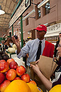 Mayor Adrian Fenty purchases a piece of fruit at the opening of the newly rebuild Eastern Market.