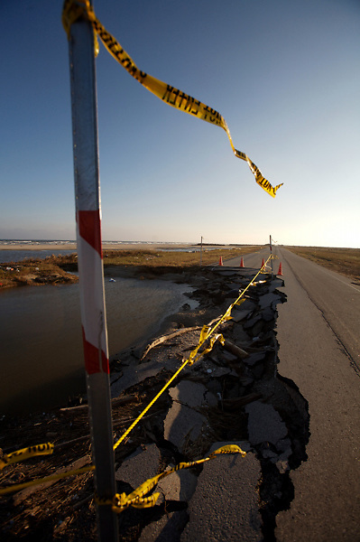 Stock photo of caution tape warning of Bluewater Highway, Brazoria County, Texas washed out by Hurricane Ike
