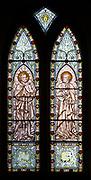 Nineteenth century Victorian stained glass window Saint Luke and Saint John, Bishops Cannings church, Wiltshire, England, UK
