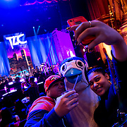 "January 30, 2013 - New York, NY : From left, Andrew and Elizabeth Fuentes snap a ""selfie"" with VH1 Blitz mascot, Iggy the Penguin, ahead of the band TLC's VH1 Super Bowl Blitz performance at the Beacon Theatre on Thursday night. CREDIT: Karsten Moran for The New York Times"