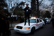 Obama Inauguration - Sunday concert on the National Mall, Washington monument and Lincoln Memorial. Police officer monitoring the crowd.