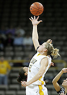 25 JANUARY 2007: Iowa forward Krista VandeVenter (51) tips the ball to a teammate at the start of overtime in Iowa's 80-78 overtime loss to Minnesota at Carver-Hawkeye Arena in Iowa City, Iowa on January 25, 2007.