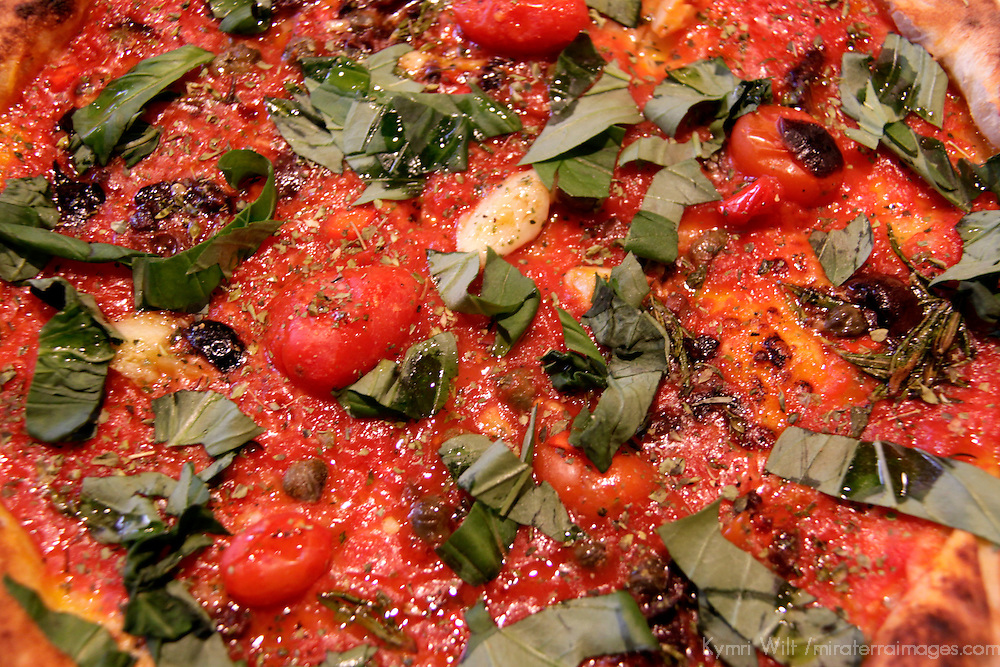 Tomatoes, Basil, Garlic and spices top this Mediterranean bread.