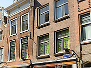 View of Amsterdam's homes, facades, windows.
