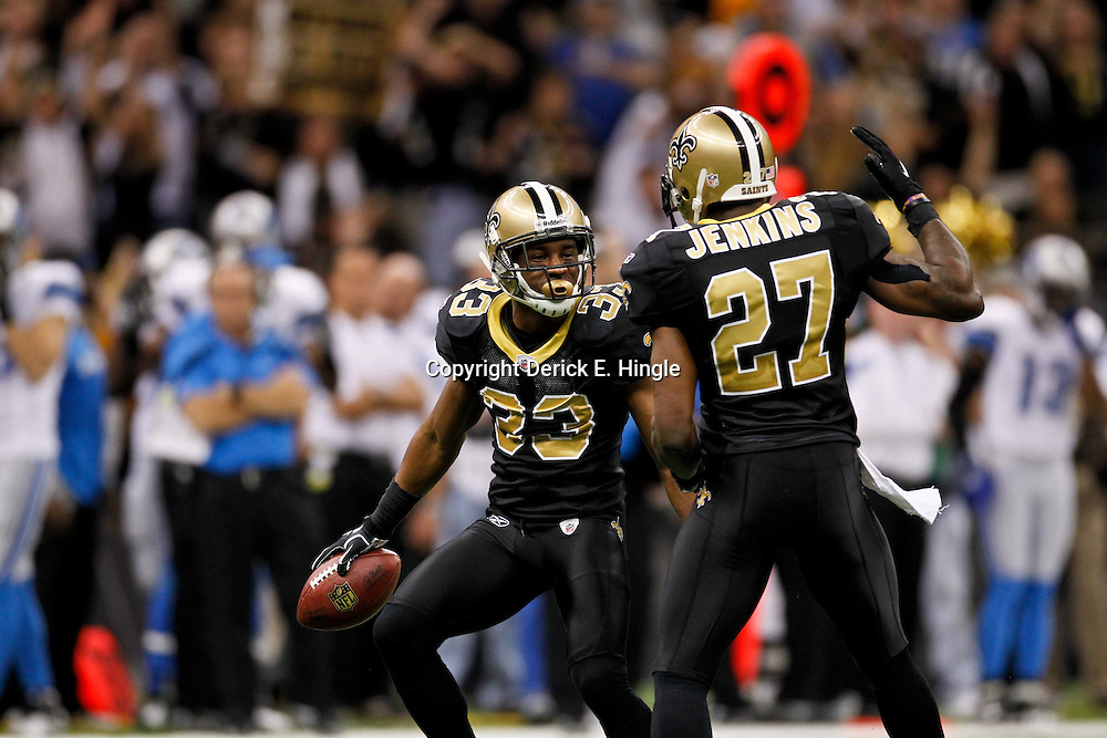 January 7, 2012; New Orleans, LA, USA; New Orleans Saints cornerback Jabari Greer (33) and safety Malcolm Jenkins (27) celebrate after an interception during the 2011 NFC wild card playoff game against the Detroit Lions at the Mercedes-Benz Superdome. Mandatory Credit: Derick E. Hingle-US PRESSWIRE