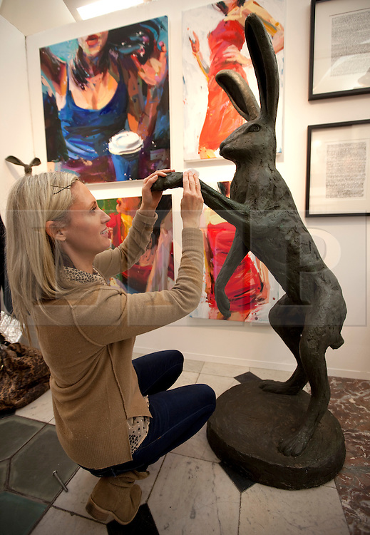 © Licensed to London News Pictures. 19/04/2012. London, U.K..Stanley dove, 'Large March Hare' at the Red Gallery section..The Setting up of The Chelsea Art Fair in Chelsea Old Town Hall where Around 35 galleries and dealers offer modern British and contemporary art for sale, including paintings, drawings, etchings and sculptures. Represents 500 international artists, with art worth up to £20k. The fair runs from 19th April - 22nd April..Photo credit : Rich Bowen/LNP