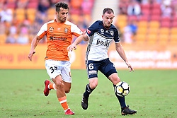 December 17, 2017 - Brisbane, QUEENSLAND, AUSTRALIA - Petros Skapetis of the Roar (33, left) and Leigh Broxham of Melbourne Victory (6) compete for the ball during the round eleven Hyundai A-League match between the Brisbane Roar and the Melbourne Victory at Suncorp Stadium on Sunday, December 17, 2017 in Brisbane, Australia. (Credit Image: © Albert Perez via ZUMA Wire)