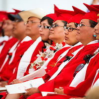 051713       Brian Leddy<br /> Navajo Technical College students listen to second-lady Jill Biden's speech Friday in Crownpoint. The school graduated 176 students at the event this year.