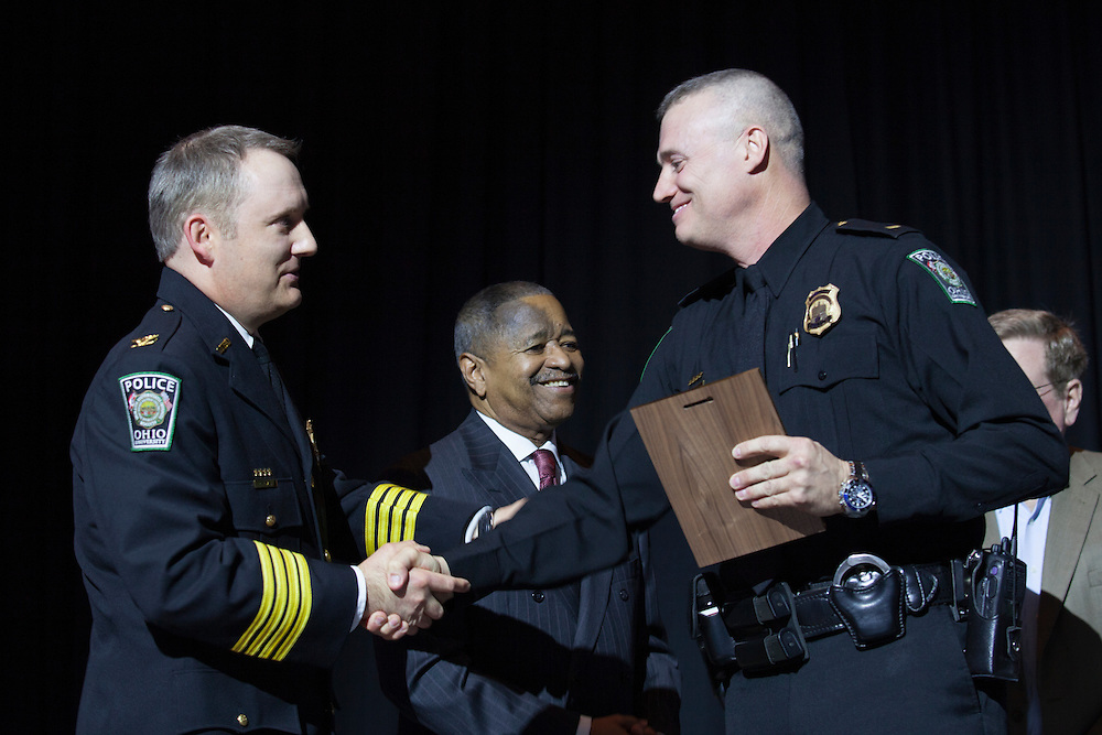 Ohio University Chief of Police Andrew Powers shakes hands with an award recipient at the Badge Pinning and Employee Recognition Ceremony on Monday, February 8, 2016. Photo by Kaitlin Owens
