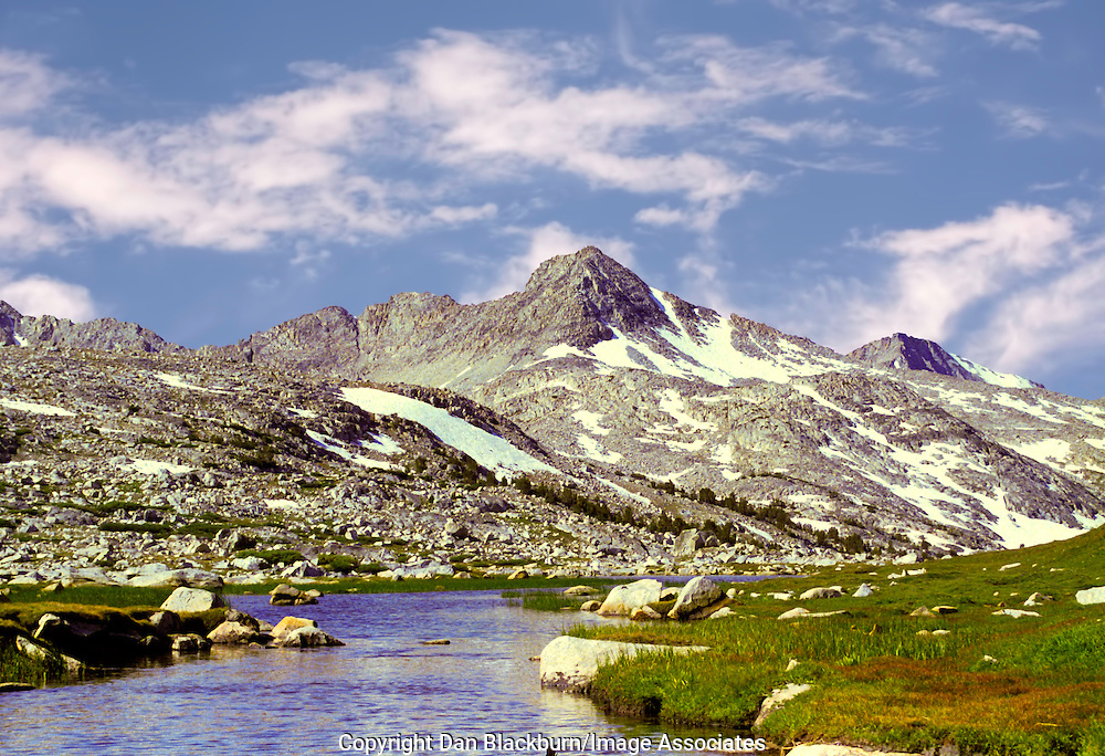 The summer sun warms Humpreys Basin and a High Sierra Stream in the Mountains of California.