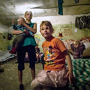 This family has been living in an abandoned soviet-era bunker since the conflict broke out last year. They were displace when shelling began killing people in their neighborhood and decided it was safer to live underground.