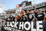 OAKLAND, CA - OCTOBER 2:  Oakland Raiders fans in The Black Hole section of the end zone cheer for their team and against the Dallas Cowboys at McAfee Coliseum in Oakland, California on October 2, 2005. The Raiders defeated the Cowboys 19-13. ©Paul Anthony Spinelli
