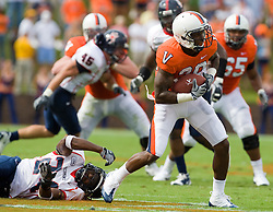 Virginia wide receiver Kevin Ogletree (20) breaks a Richmond defensive back Seth Williams (24) tackle.  The Virginia Cavaliers defeated the #3 ranked (NCAA Division 1 Football Championship Subdivision) Richmond Spiders 16-0 in a NCAA football game held at Scott Stadium on the Grounds of the University of Virginia in Charlottesville, VA on September 6, 2008.