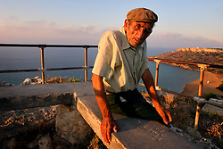 MALTA GOZO RAMLA 24JUL06 - Old Maltese farmer Joe Cremona enjoys the view above Ramla Valley before a typically colourful summer sunset on Gozo...jre/Photo by Jiri Rezac..© Jiri Rezac 2006..Contact: +44 (0) 7050 110 417.Mobile:  +44 (0) 7801 337 683.Office:  +44 (0) 20 8968 9635..Email:   jiri@jirirezac.com.Web:    www.jirirezac.com