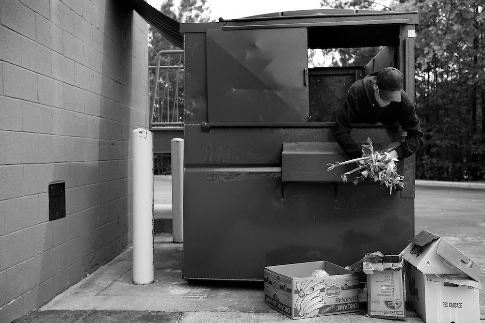 Trace R. Dumpster-dives in Pittsboro. Some of the items gathered will be given to the pigs on his farm, but others will be eaten by people, depending on the quality and freshness of the food.