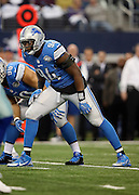 Detroit Lions defensive end Ezekiel Ansah (94) gets set for the snap during the NFL week 18 NFC Wild Card postseason football game against the Dallas Cowboys on Sunday, Jan. 4, 2015 in Arlington, Texas. The Cowboys won the game 24-20. ©Paul Anthony Spinelli