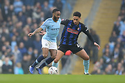 7 Raheem Sterling for Manchester City and Rotherham United midfielder Ryan Williams (23) during the The FA Cup 3rd round match between Manchester City and Rotherham United at the Etihad Stadium, Manchester, England on 6 January 2019.