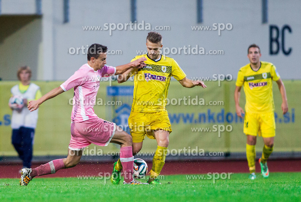 Nemanja Maksimovic #19 of Domzale vs Niko Snoj of Radomlje during football match between NK Kalcer Radomlje and NK Domzale in 8th Round of Prva liga Telekom Slovenije 2014/15, on September 13, 2014 in Sports park Domzale, Slovenia. Photo by Vid Ponikvar  / Sportida.com