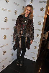 EVA HERZIGOVA at a party hosted by Roberto Cavalli to celebrate his new Boutique's opening at 22 Sloane Street, London followed by a party at Battersea Power Station, London SW8 on 17th September 2011.